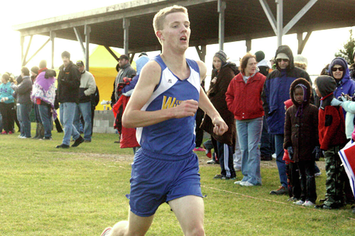 FINISHING STRONG: David Zinger heads to the finish line at the Pine River Invitational Saturday (Herald Review photo/John Raffel)