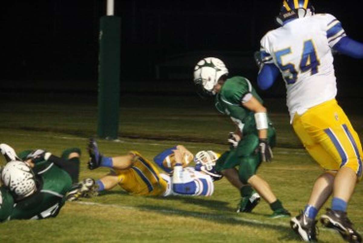 DEFENSE OF STEEL: Pine River players go after the running back during recent action. (File photo)