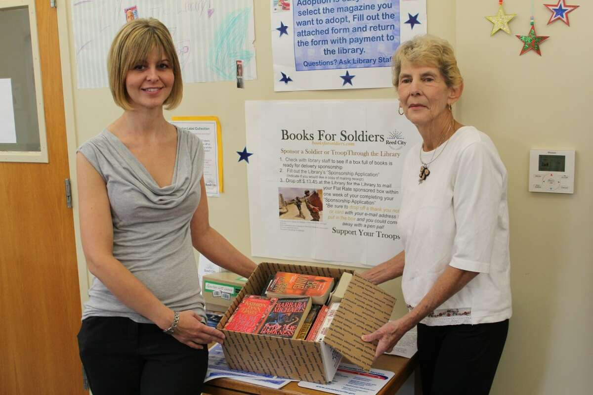 SENDING BOOKS: The Reed City Library accepts sponsors for two boxes of books to be sent to soldiers each month. To date, the library has sent 10 boxes overseas through the Books for Soldiers program. (Herald Review photo/Sarah Neubecker)