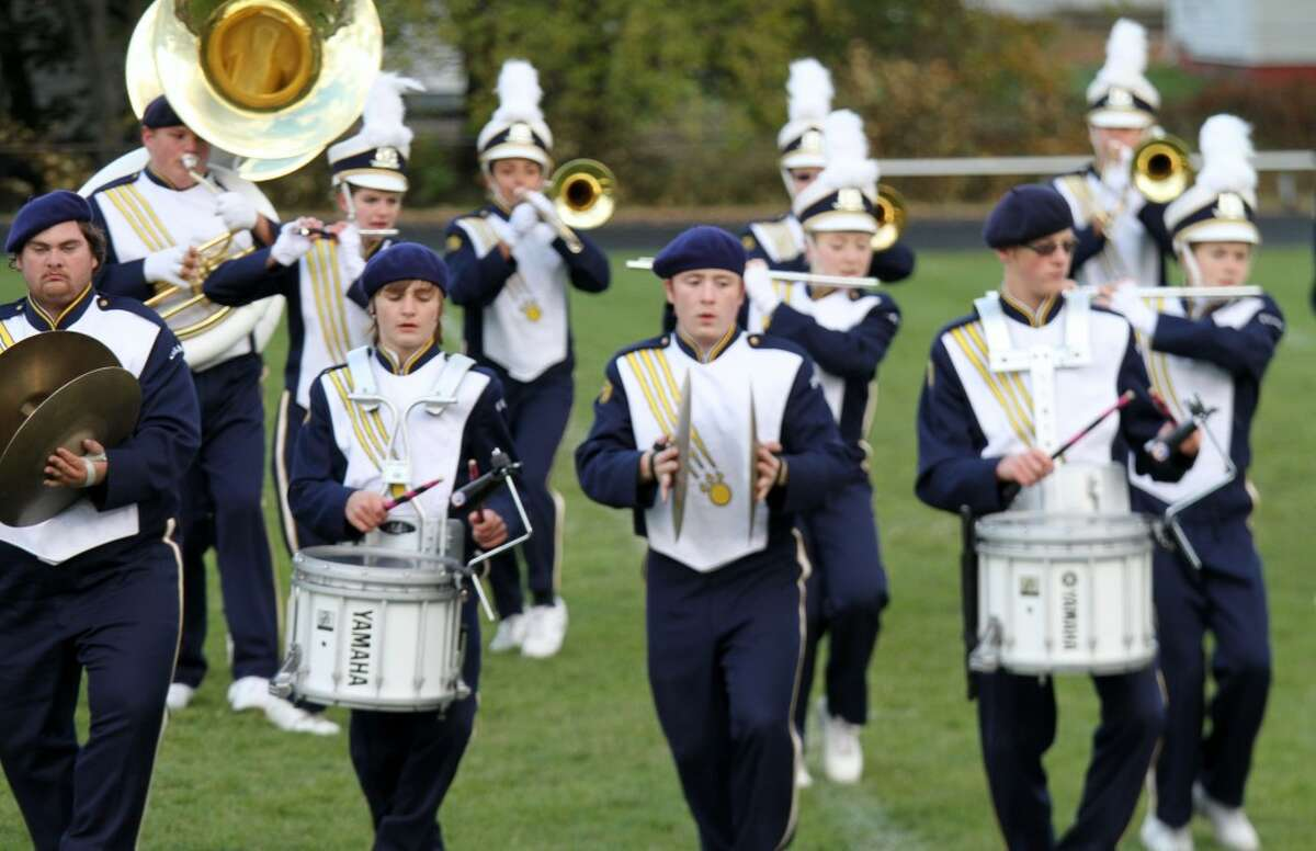 """GETTING FUNKY: Evart High School's marching band chose a """"funk"""" theme for its festival performance on Wednesday. (Herald Review photos/Lauren Fitch)"""