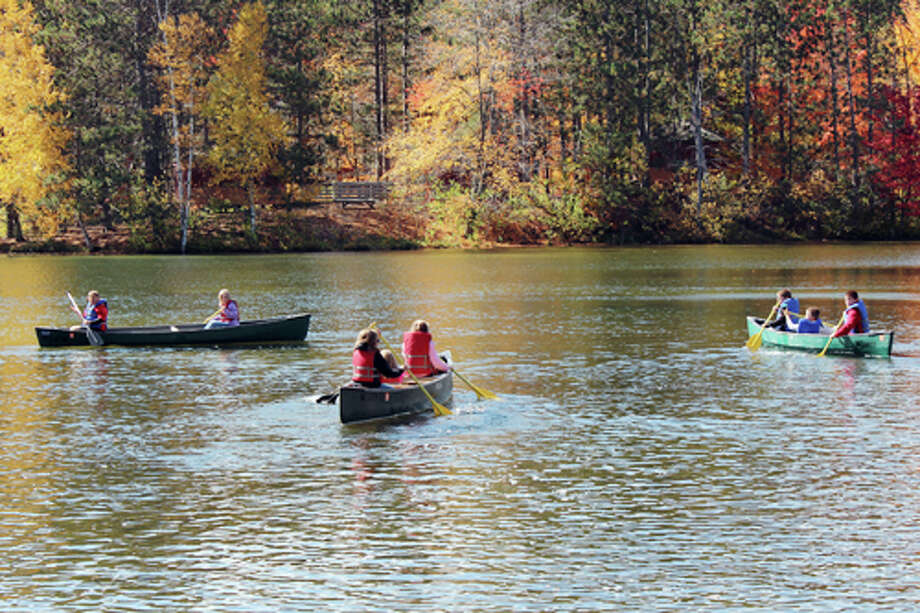 OUTDOOR EXPERIENCE: Fourth grade students in Denise Nelson's class canoe on the Muskegon River at Spring Hill. The students took a field trip to the camp on Friday.
