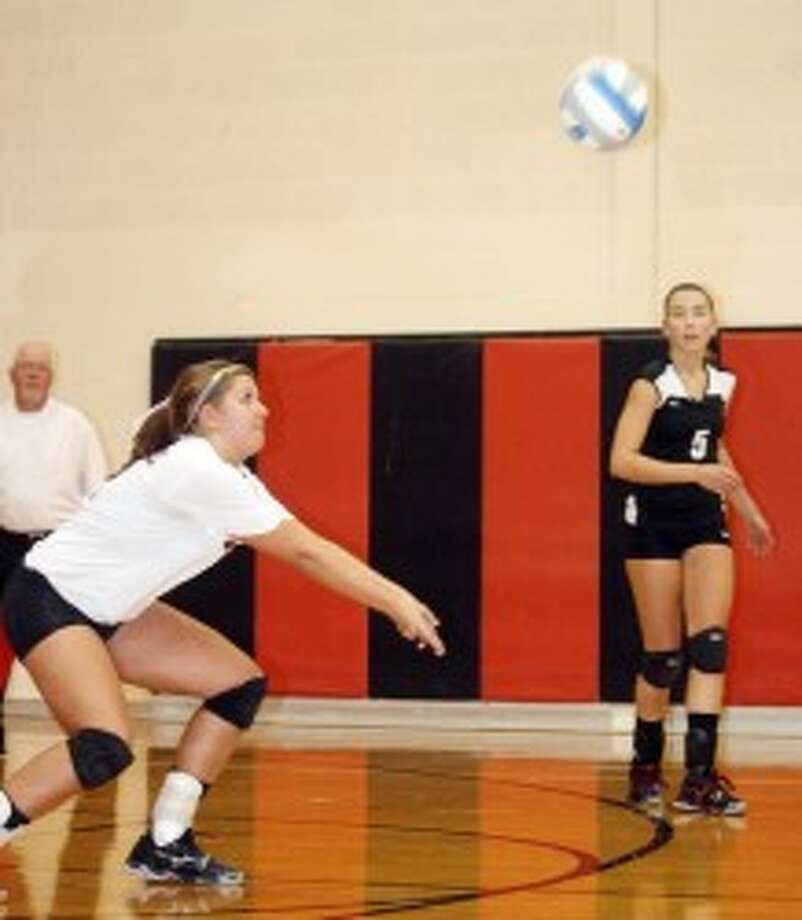 READY, SET...: Reed City volleyball's Kalee Hensel makes the pass while teammate Jacolyn Mullins watches the action. (File photo)