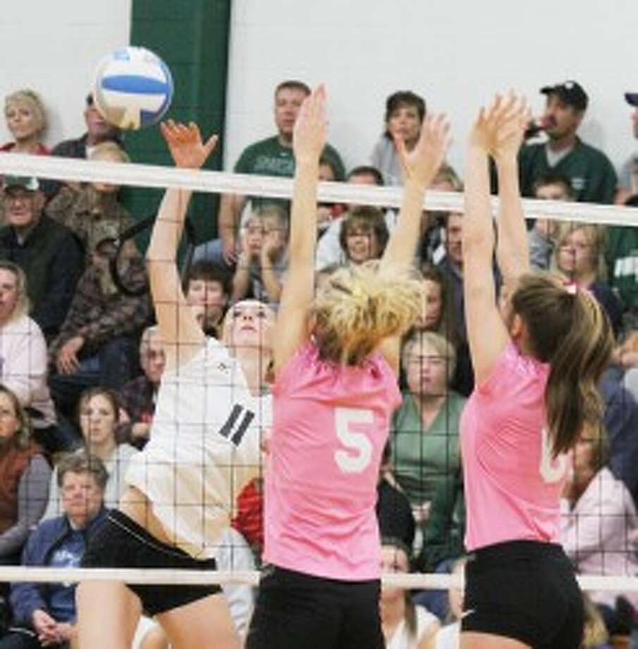 ON THE ATTACK: Pine River's Elizabeth Whitley looks to put down a kill on the attack Tuesday against McBain. (Herald Review photo/Martin Slagter)