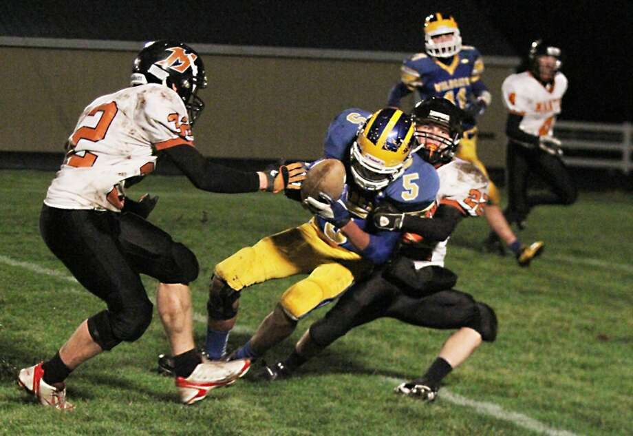 HAPPY ENDING: Evart's Chapman Long fights for extra yardage on Friday. (Herald Review photo/Bob Allan)
