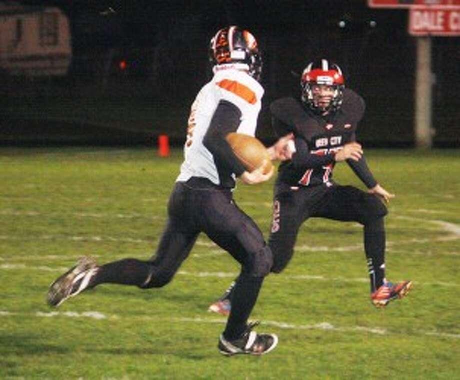 STAY WITH IT: Reed City's Ricky Droke comes up to make a tackle against White Cloud on Friday. (Herald Review photo/John Raffel)