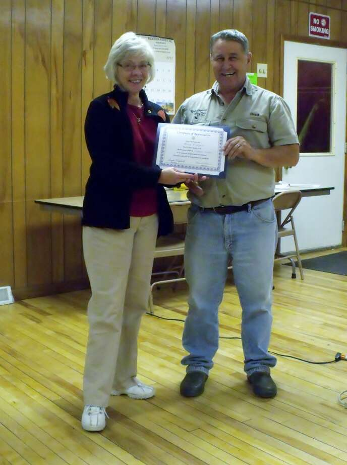MEETING SPEAKER: Lions Club President Therese Whitten (left) presents an award to Brad Morgan, of Morgan Composting, for speaking at the Lions Club meeting. The group meets twice a month at the Evart Township Hall to fellowship and discuss ways to improve the community. (Herald Review photo/Jim Crees)