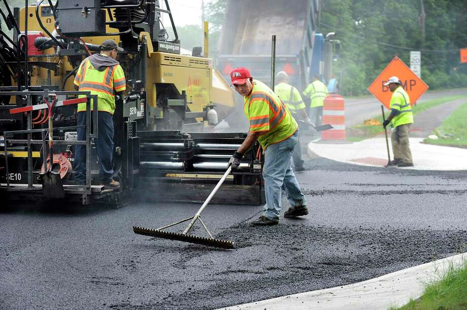 File photo from Wednesday , June 7, 2017 of workers from A & J Construction paving the roads at the intersection of Plumtrees Road and Whittlesy Drive in Bethel. A section of Plumtrees Road will be closed on Wednesday, Aug. 21 for paving. Photo: Carol Kaliff / Hearst Connecticut Media / The News-Times