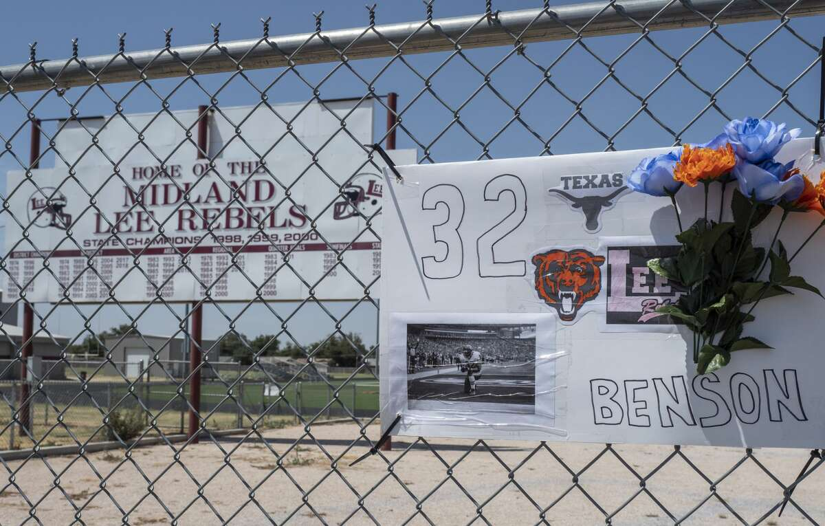 A small memorial for Cedric Benson is on the fence 08/19/19 outside the Lee High School track and football practice field. Tim Fischer/Reporter-Telegram