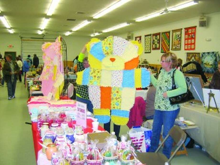 ANIMAL QUILTS: Fun animal-shaped quilts for kids by Linda Proefrock of Big Rapids. (Courtesy photos)