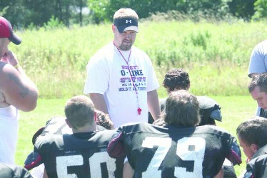 PREPARATION: Reed City football head coach Monty Price instructs his players during a practice earlier this year. (File photo)