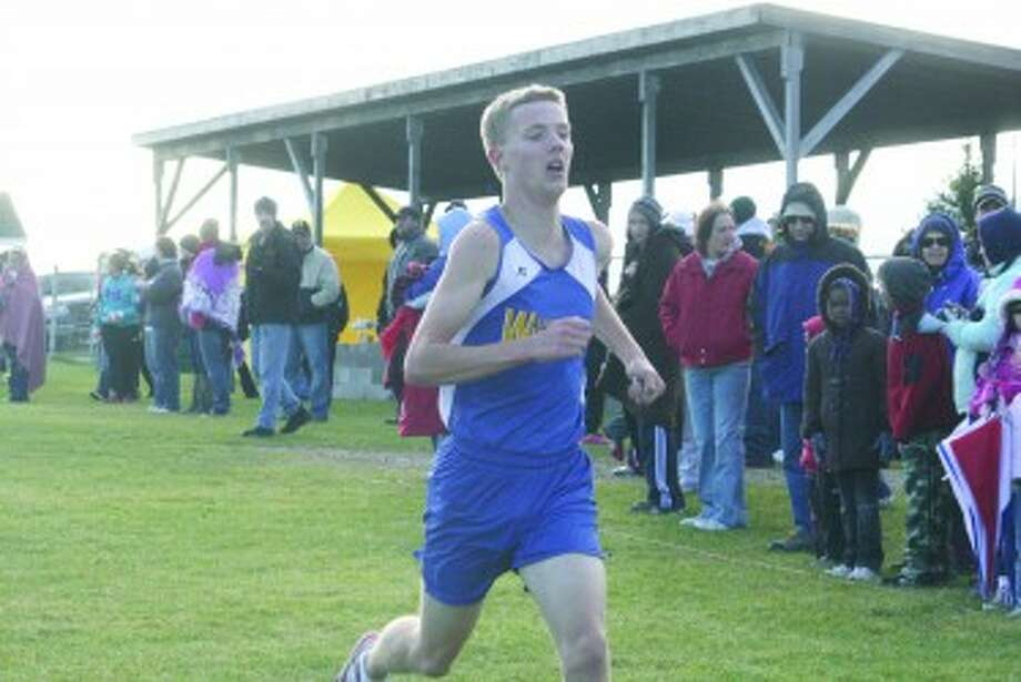 ENDING STRONG: David Zinger of Evart will run his last high school cross country race Saturday in the state finals. (File photo)