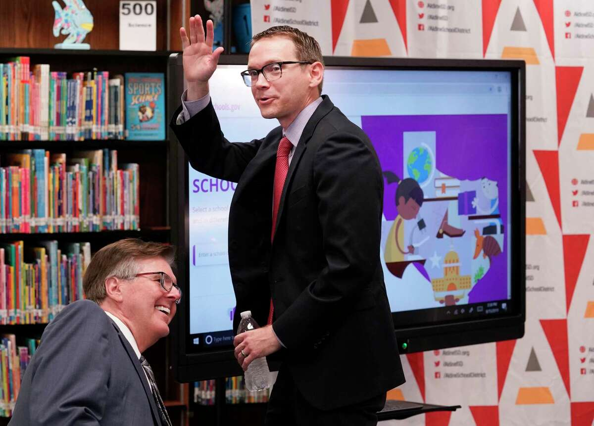 Mike Morath, Texas Education Agency commissioner, right, walks past Dan Patrick, Texas Lt. Governor, and waves as he leaves from the Texas Education Agency press conference at Stephens Elementary, 2402 Aldine Mail Route Road, Thursday, Aug. 15, 2019, in Houston.