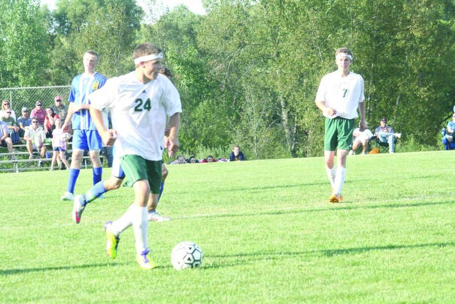 LINE OF DEFENSE: Larry Kissinger (24) was Pine River's defensive leader this season. (File photo)