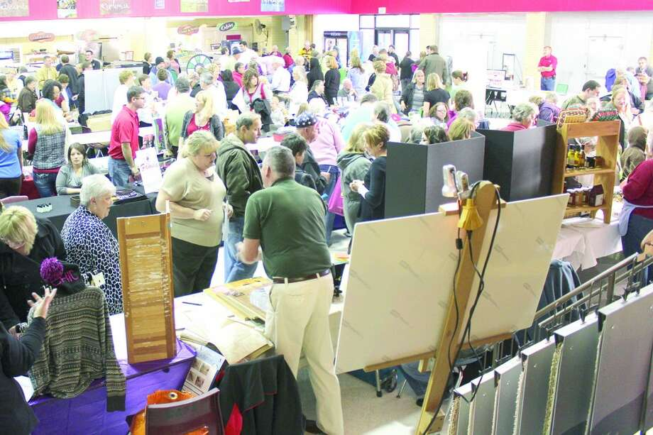NETWORKING: Hundreds of people attended the ninth annual Reed City Business Expo at Reed City High School on Nov. 1. The event featured prizes, drawings, giveaways and networking with others.