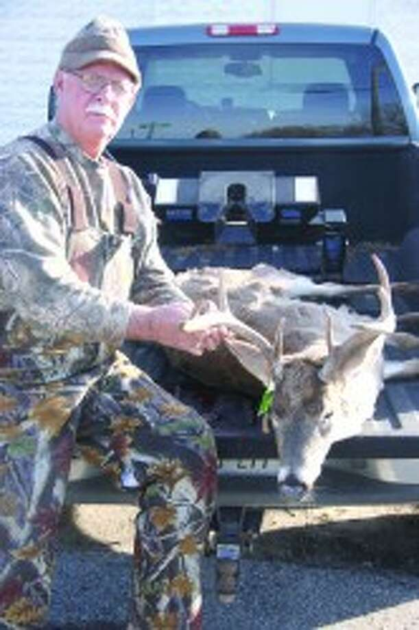 BIG BUCK: First Place honors in the 2011 Evart Big Buck Contest went to David Hubbard who shot a beautiful 9 point buck with a spread of 18 1/2 inches in the Emerald Lake area. (Herald Review file photo)