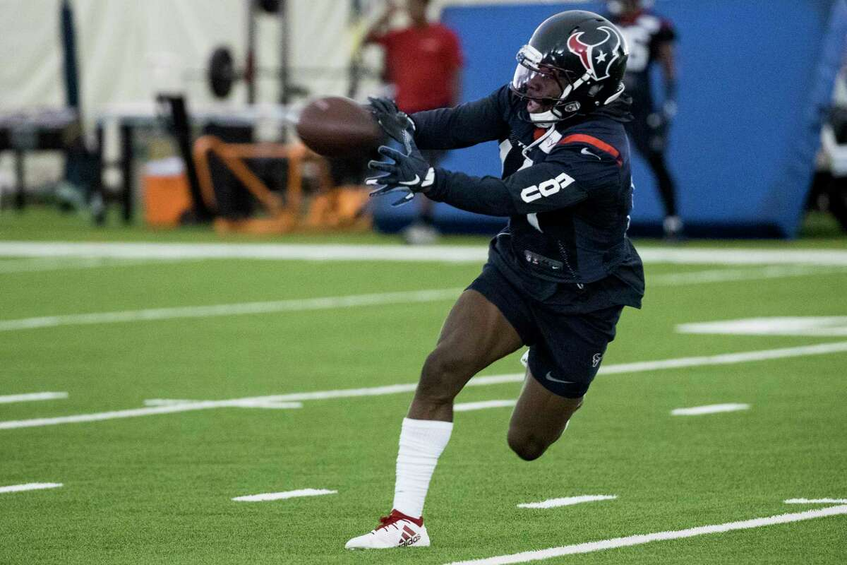 Houston Texans wide receiver DeAndre Carter runs across the field to make a catch during training camp at the Methodist Training Center on Monday, Aug. 19, 2019, in Houston.