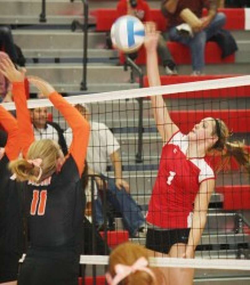 MOVING ON: Reed City's volleyball team advanced to Thursday's regional final with a 3-0 win over Belding on Tuesday. (Herald Review photo/John Raffel)