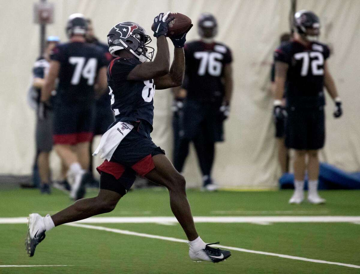 Houston Texans wide receiver Floyd Allen (82) comes down with a catch downfield during training camp at the Methodist Training Center on Monday, Aug. 19, 2019, in Houston.