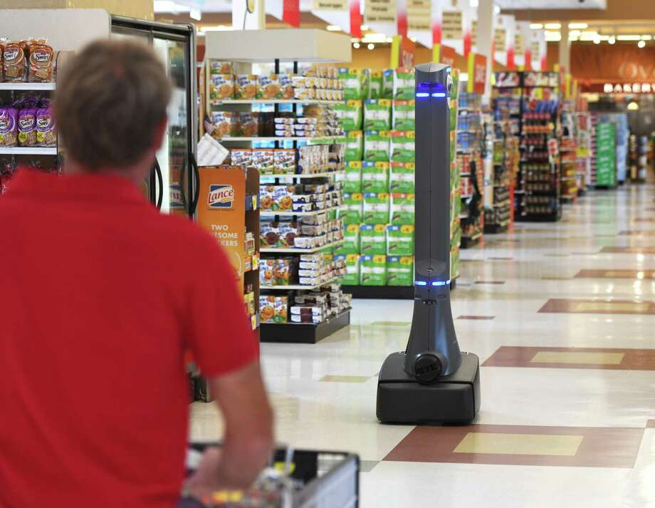 Marty the robot roams the aisles of the West Main Street Stop & Shop in Stamford, Conn. Monday, Aug. 19, 2019. Marty is programmed to scan the aisles for spills and notify real human employees of any potential problems. Stop & Shop now has a Marty in 81 of its 92 Connecticut stores. Photo: Tyler Sizemore / Hearst Connecticut Media / Greenwich Time