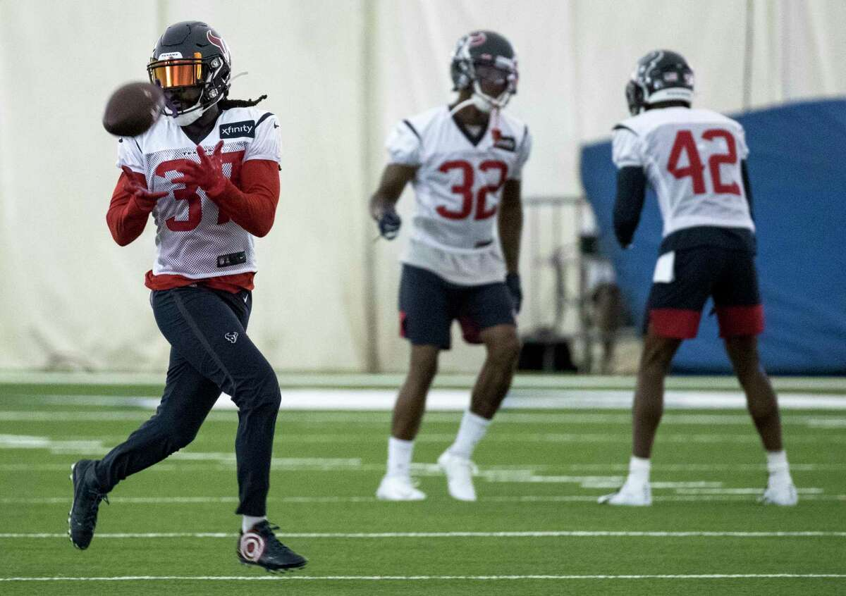 Houston Texans strong safety Jahleel Addae (37) makes a catch during training camp at the Methodist Training Center on Monday, Aug. 19, 2019, in Houston.