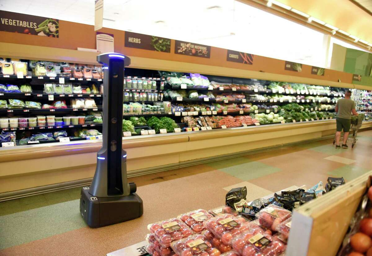 Marty the robot roams the aisles of the West Main Street Stop & Shop in Stamford, Conn. Monday, Aug. 19, 2019. Marty is programmed to scan the aisles for spills and notify real human employees of any potential problems.