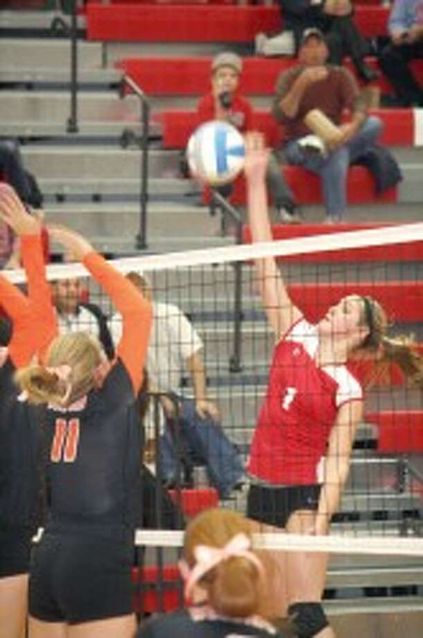 SPIKE: Reed CIty's Michaela Reed gets set to hit the ball over the net against Belding. (Herald Review photo/John Raffel)