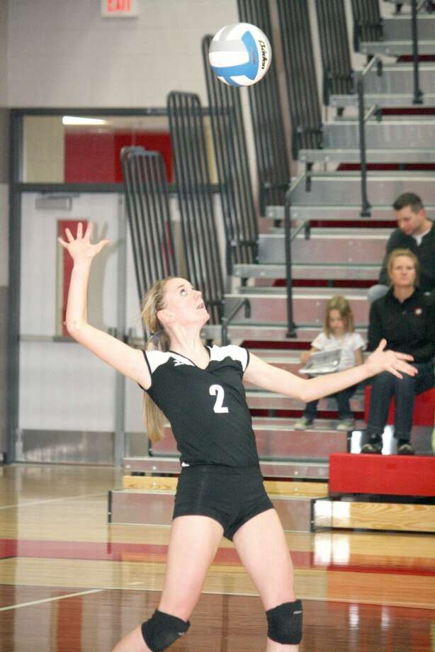 SERVE: Emma Lockhart gets ready to serve the ball for Reed City against Whitehall. (Herald Review photo/John Raffel)