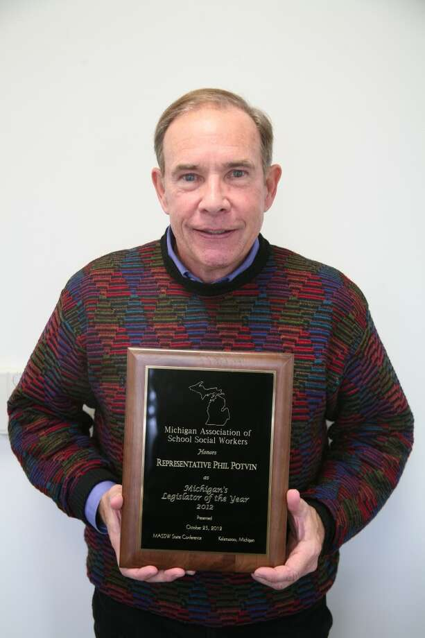 HONORED: State representative Phil Potvin receives the award for Michigan's Legislator of the Year by the Michigan Association of School Social Workers.