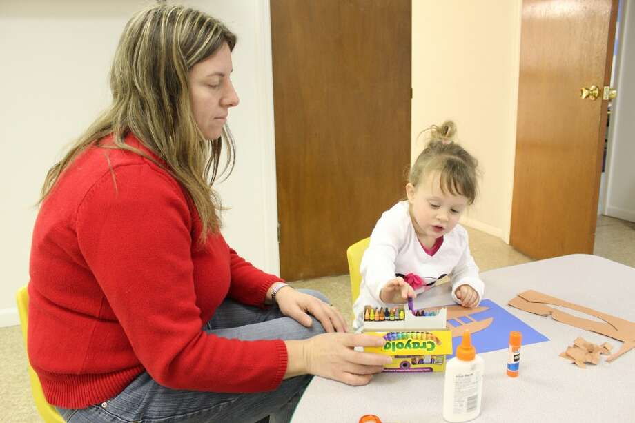 LEARNING: Henrietta DuBreuil, left, works with Tatum, 2, at the Rooted to Grow Learning Center in LeRoy. The center opened Nov. 5 and offers a place for children age 33 months to five years old to learn with curriculum in conjunction with Pine River School District. (Herald Review photo/Sarah Neubecker)