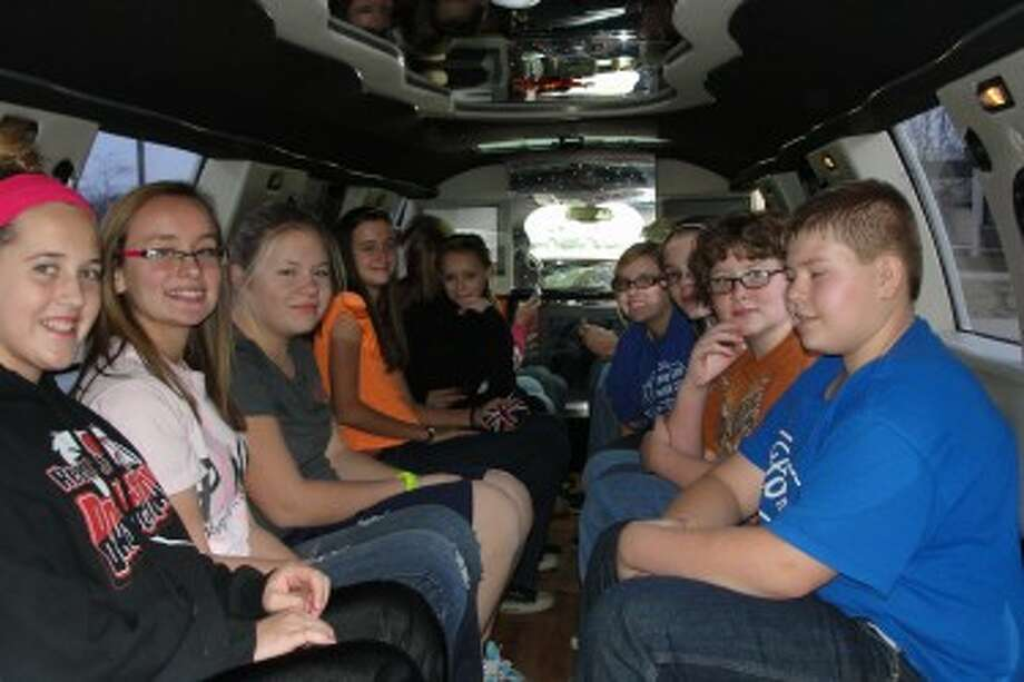 RIDING IN STYLE: Students were smiling with excitement as they see the inside of a limousine for the first time.