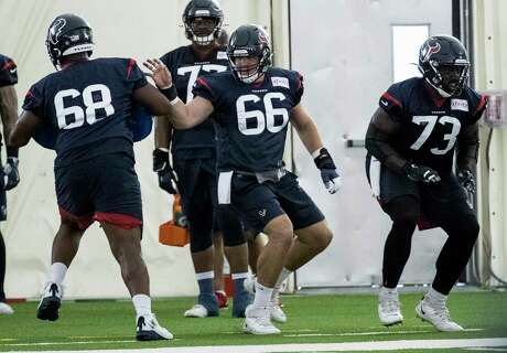 Houston Texans center Nick Martin (66) runs a blocking drill against guard Malcolm Pridgeon (68) during training camp at the Methodist Training Center on Monday, Aug. 19, 2019, in Houston.