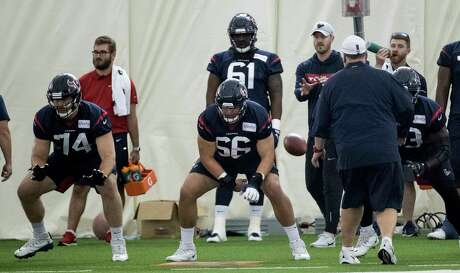 Houston Texans center Nick Martin (66) snaps the ball as he lines up with guards Max Scharping (74) Zach Fulton (73) during training camp at the Methodist Training Center on Monday, Aug. 19, 2019, in Houston.