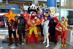 McThor (Brandon Isaacson) poses with a group of McVengers.   From left to right: Jason Liebowitz as Star Lord Jr. (Star Lord and Carl's Jr.); Jab as Long John Fury (Nick Fury and Long John Silver); Eevee as Baskyrie (Valkyrie and Baskin Robbins); Lola/Dynamic_Dyad as Maria Fields (Maria Hill and Mrs. Fields); Brandon Isaacron as McThor (Thor and McDonald's); Doc Cane Cosplay as the Incredible Panda Express (The Incredible Hulk and Panda Express); Yaudiel Flores as Burger LoKing (Loki and Burger King); Paul Mobile Knobel as Colonel America (Captain America and KFC); Nerd Alert Cosplay as Iron Taco (Iron Man and Taco Bell); Miranda Herman/Princess Squib as Captain CinnaMarvel (Captain Marvel and Cinnabon); BananaSteve.Cosplay as Grimos (Thanos and Grimace/McDonald's); Christine Knobel/the Starflower as Wendy's Widow (Black Widow and Wendy's); Jack in the Box Strange; KittieCosplay as Jolliwasp (The Wasp and Jollibee) and Baby Groot Fries.