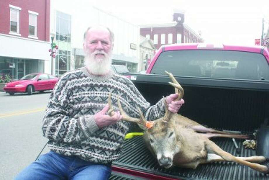 8 POINT: Bob Pinsch, 67, of Hersey, used one shot from his 30.06 to bag an 8-point buck with 16-inch rack span Saturday afternoon on his property. (Herald-Review photos/John Raffel)