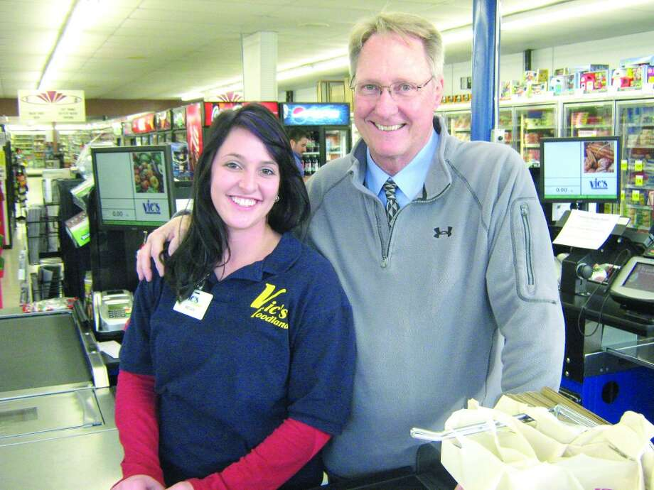 COMMUNITY SUPPORT: Spectrum Health Reed City President Sam Daugherty (right) stands with Vic's Supermarket cashier Megan Smith during the Celebrity Bagging Event. More than $2,000 was raised for the Susan P. Wheatlake Regional Cancer Center at the event. (Courtesy photos)