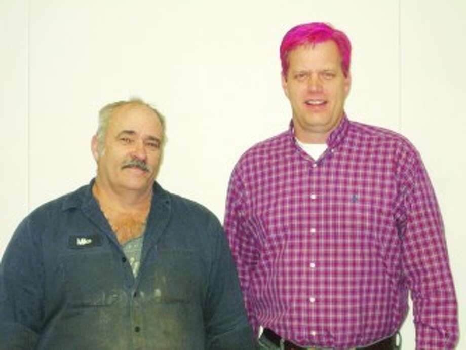 VACATION TIME: Mosaic Potash site manager Karl Tomaszesski (right) dyed his hair pink after the company met its United Way fundraising goal. Employee Mike Copeman (left) won 40 hours of vacation time at a reception held in celebration of the success. (Courtesy photos)