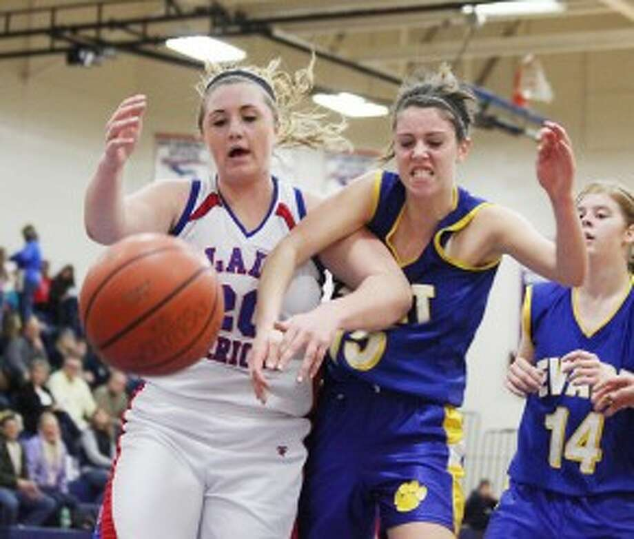FIGHT FOR IT: Chippewa Hills' Kendall Boone battles for a loose ball with Evart's Mara VanOrder on Friday. (Pioneer photo/Bob Allan)