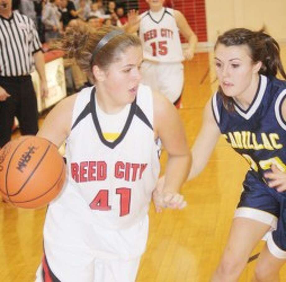 DRIVING: Reed City's Karah Hensel looks to drive to the basket during Friday's high school basketball action against Cadillac. (Pioneer photo/John Raffel)