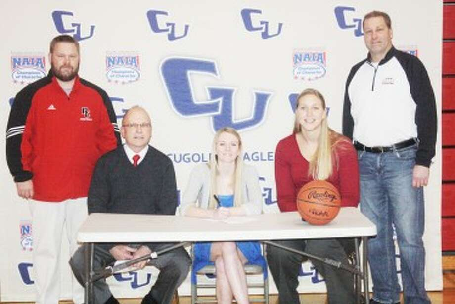 SIGNING: Emma Lockhart signs her letter-of-intent with athletic director Monty Price, girls basketball assistant coach Tim Webster, Cornerstone coach Katie Mattera and Reed City girls basketball coach Brian Koopman. (Pioneer photo/John Raffel)