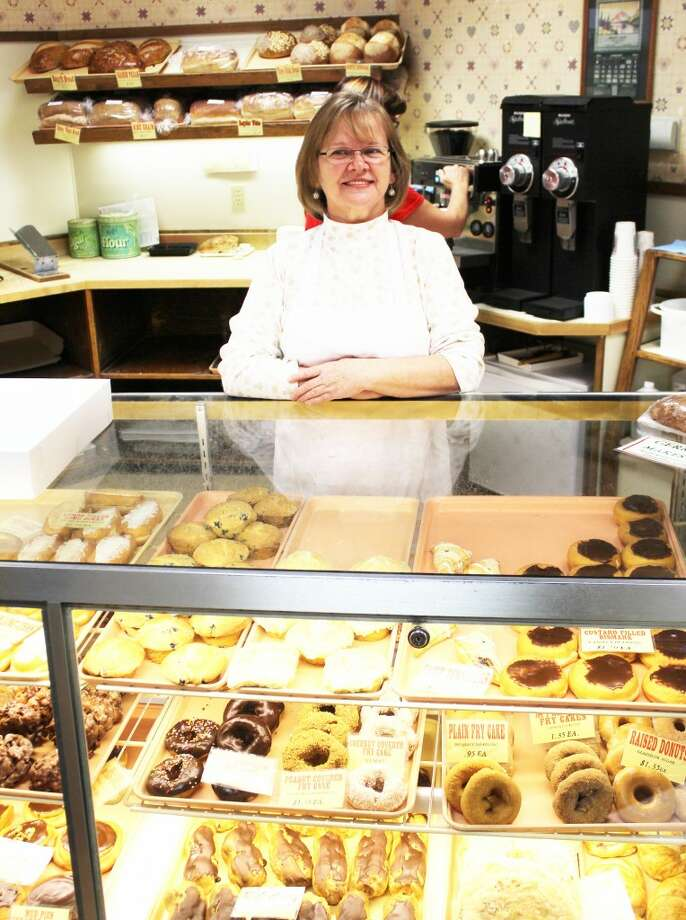 MAY I HELP YOU?: Working at Wright's Bake Shop for seven years, Deb Merriss loves working with the customers. She comes in as early as 5 a.m. to frost cookies, help others and put a smile on customers' faces.