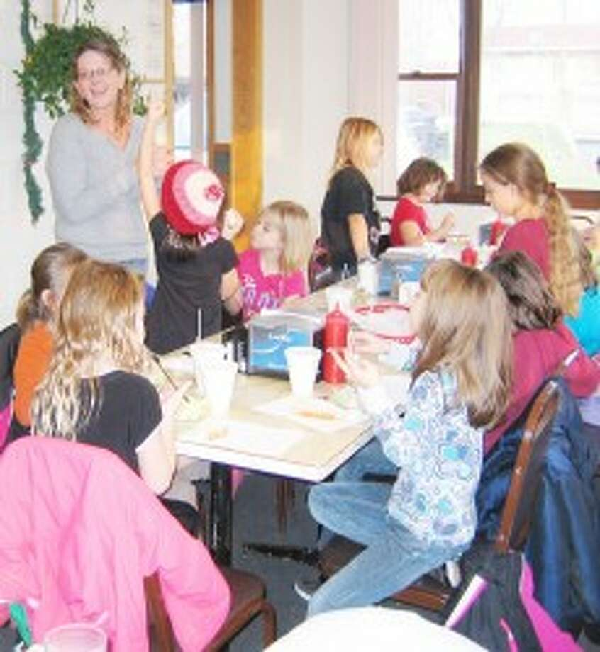 FOODFACTS: Ronnie Duncan (standing) talks to Brownies about healthy eating. (Courtesy photo)
