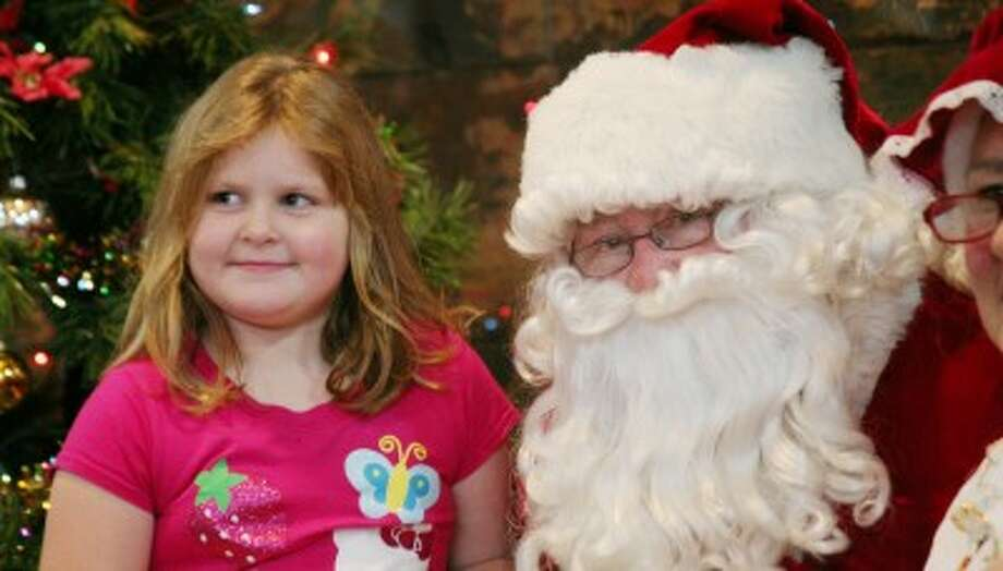 MEETING SANTA: Young and old friends had a chance to meet with Saint Nick during Christmas in a Smalltown celebrations