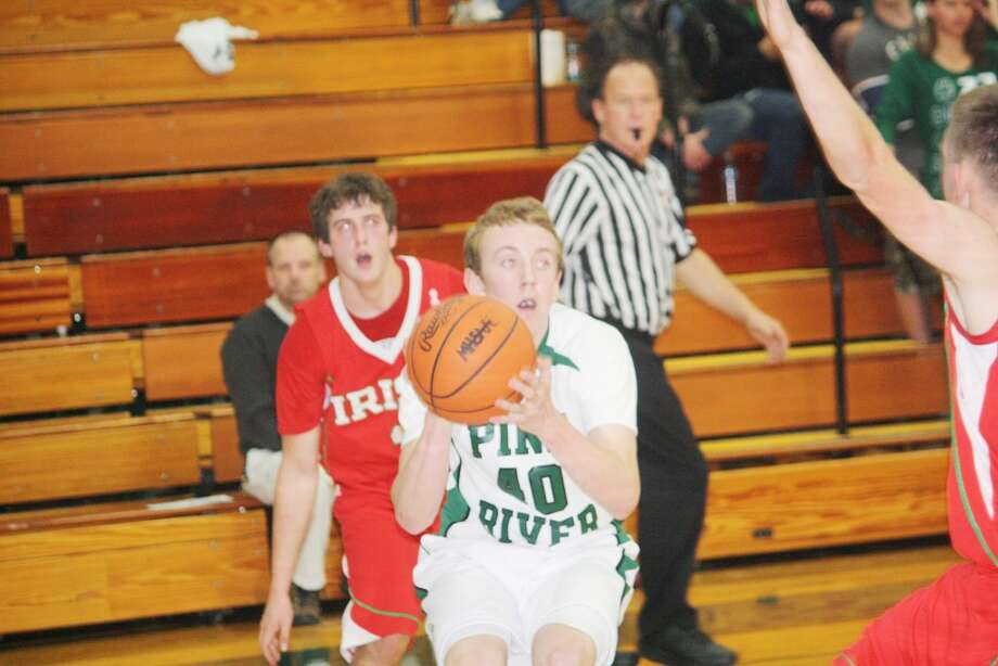 Lucas Harris (40) of Pine River looks to make a move against Sacred Heart. (Herald Review photo/John Raffel)