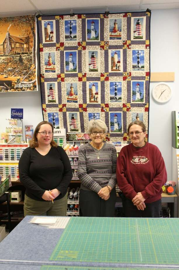 QUILTERS: Crossroads Quilt Shop sells material, yarn, books and other items for quilters. Pictured (from left) is Kim Venema, owner Patsy Blue and Shirleen Vanover. Not pictured is Denise Archer. (Herald Review photos/Sarah Neubecker)