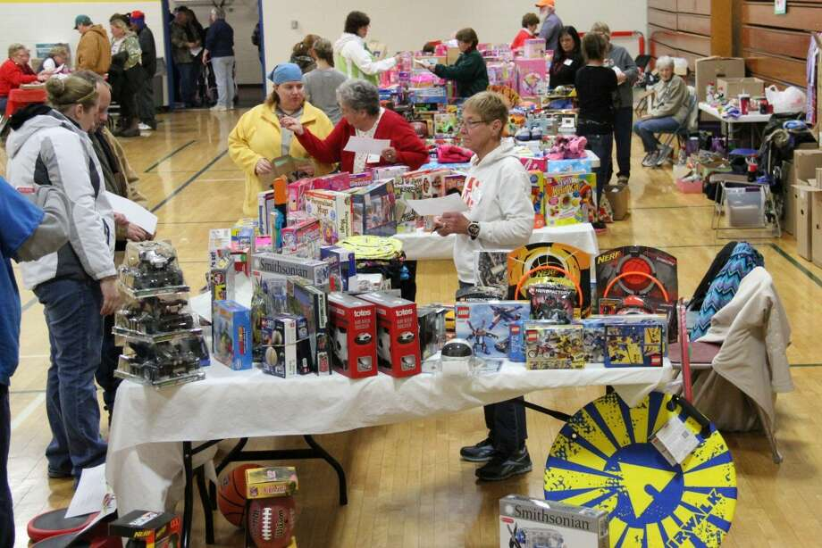GIFTS FOR KIDS: In the spirit of holiday giving presents were distributed to 291 low-income families in need, an increase of nearly 50 families from last year. (Herald Review photos/Sarah Neubecker)