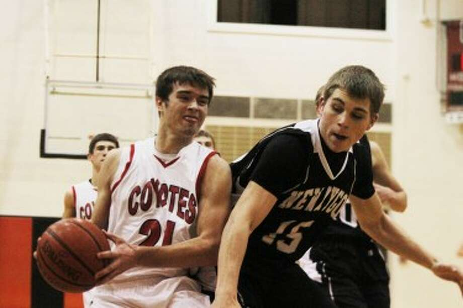 AND ONE: Reed City's Chad Samuels (left) is fouled on his way to the basket against Newaygo on Monday in boys basketball action. (Pioneer photo/Bob Allan)