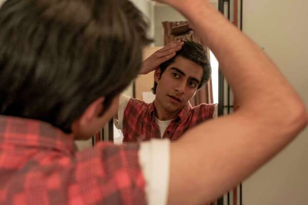 This image provided by Warner Bros. Entertainment Inc. shows Viveik Kalra in a scene from a€œBlinded by the Light,a€ a Warner Bros. Pictures release in which Kalra plays Javed, a Pakistani-British teen whose life is transformed when a friend introduces him to Bruce Springsteena€™s music in 1987 Britain. (Nick Wall/Warner Bros. Entertainment Inc. via AP)