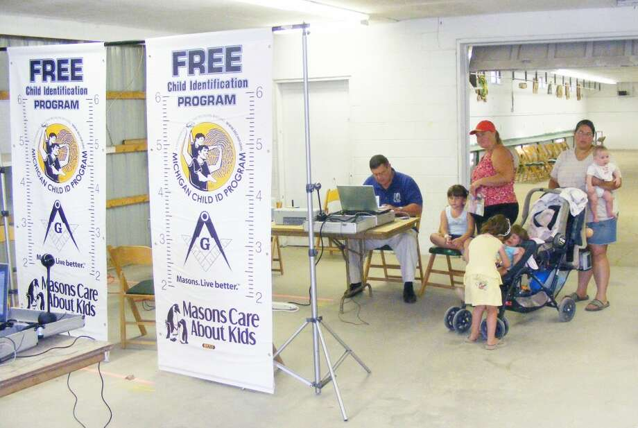 CHILD ID PROGRAM: The Evart Masonic Lodge participates in the Michigan Child ID Program, which provides identifying information such as a child's height, weight, picture and voice recording to assist in searching if a child goes missing. The group facilitates the program at community events such as National Night Out in August and the Marion and Osceola County fairs. (Herald Review file photos)