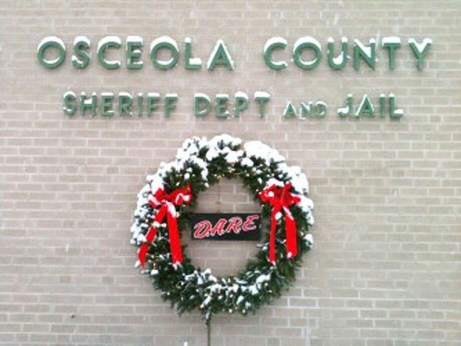 HOLIDAY BEHIND BARS: Serving sentences for crimes, inmates at the Osceola County jail will spend Christmas day behind bars. Forgotten Man Ministries will host a Christmas service and jail administration will serve pizza and pop to treat inmates special for the holidays. (Courtesy photo)