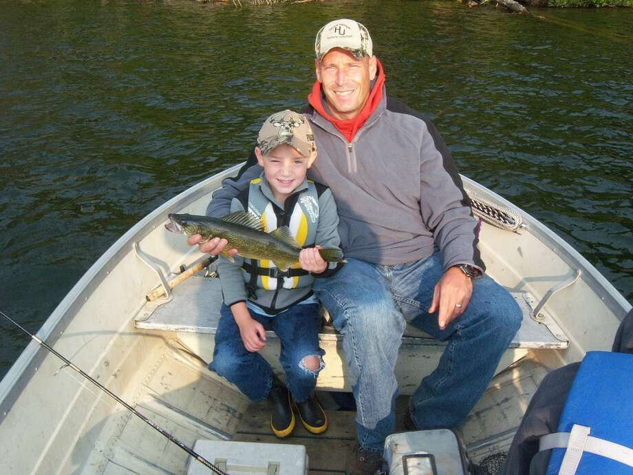 UP NORTH: Jay Wallace of Evart, and his son, Preston, at their Canada fishing trip last summer. (Courtesy photo)